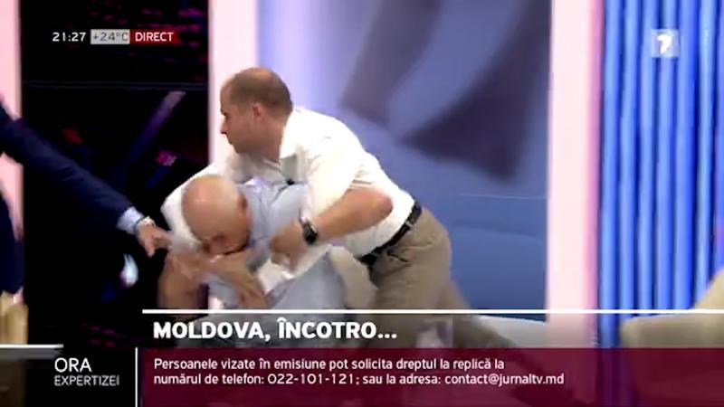 """(video) Bătaie în direct! Sergiu Tofilat l-a pus la pământ pe fostul polițist, Cosovan: """"Ești nebun?""""/""""Dă-l băi în na*er!"""""""